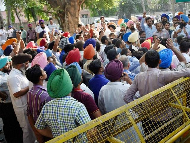 Diesel taxi drivers hold a protest outside the Supreme Court in New Delhi.