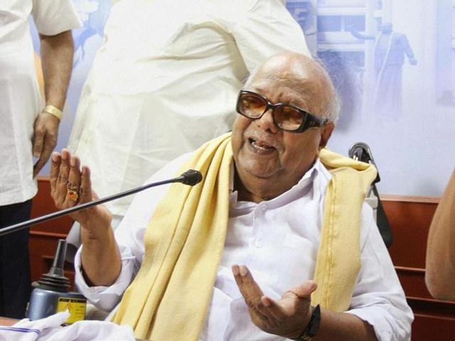 DMK chief M Karunanidhi with his son MK Stalin at a meeting of party members in Chennai.
