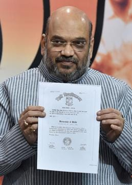 Prime Minister Narendra Modi's graduation degree (L), awarded by the Delhi University and Post-graduation degree from Gujarat University which were shown by BJP President Amit Shah and Finance Minister Arun Jaitley during a press conference at BJP headquarters in New Delhi o