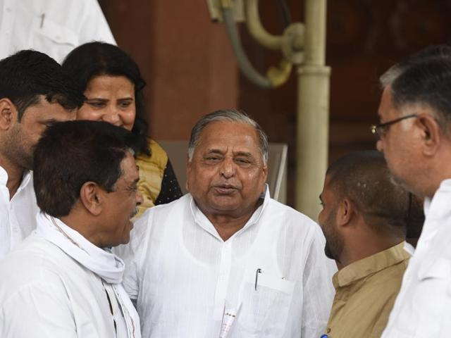 Samajwadi Party Chief and Lok Sabha MP Mulayam Singh Yadav with his party supporter's leave after attending parliament Session in New Delhi. ( Photo by Sonu Mehta/ Hindustan Times)