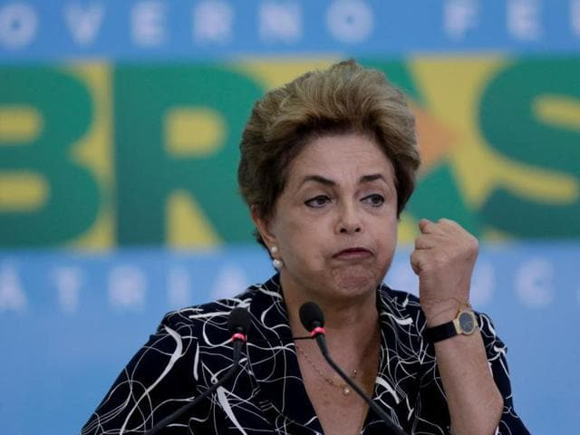 Sao Paulo : People protest next to large inflatable doll of Brazil's President Dilma Rousseff wearing a presidential sash with the words