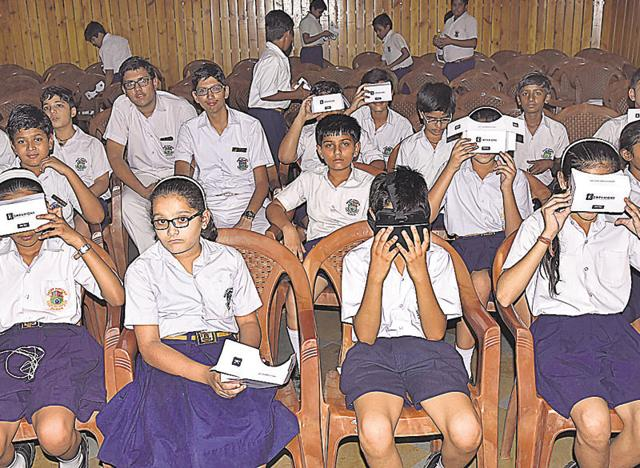 Students watch a virtual reality video on solar system, in Jaipur on Tuesday.