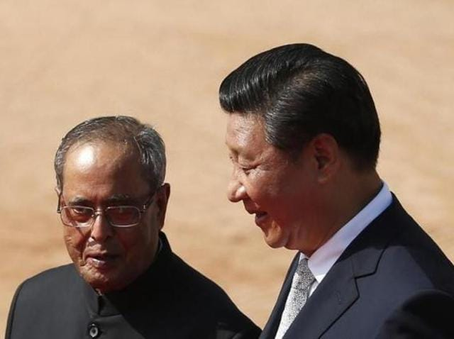 File photo of President Pranab Mukherjee (left) with his Chinese counterpart Xi Jinping during his visit to India in September 2014