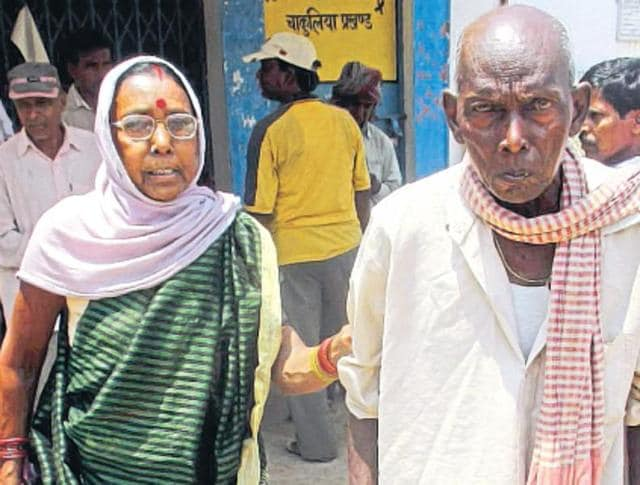 Mahadev Nayak, who was declared dead in government record for 7 years, with his wife at Chakulia block office in Ghatsila.