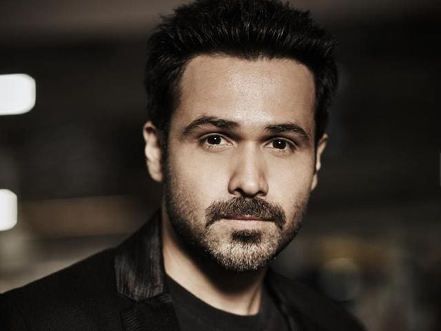Actor Emraan Hashmi jokes that he has to cover his son's eyes every time his kissing scene comes on screen.