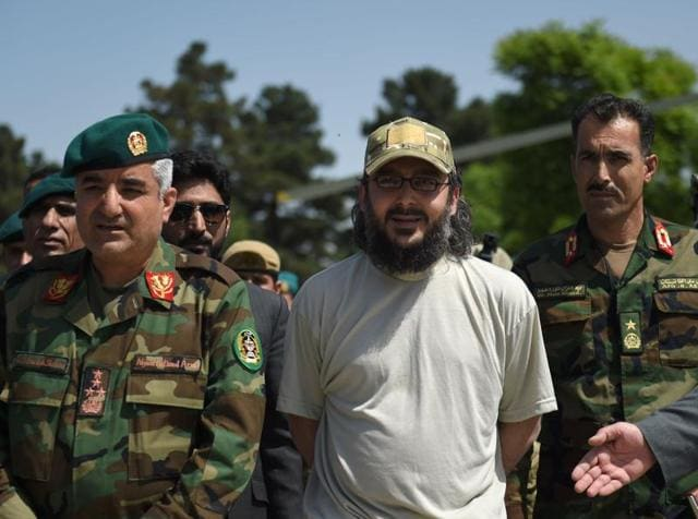 The son of former Pakistani prime minister Yousaf Raza Gilani, Ali Haider Gilani, (C) looks on as he is escorted by Afghan Special Forces personnel from an Afghan National Army helicopter at the Ministry of Defence in Kabul on May 11, 2016.