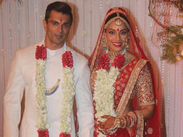 Bipasha Basu wore a heavily embroidered gold and red lehenga, which was exclusively designed for her by Sabyasachi Mukherjee.