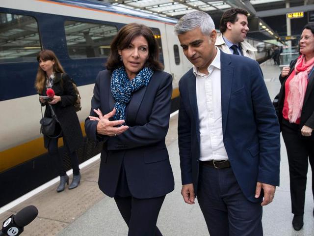 Mayor of London Sadiq Khan speaks with Mayor of Paris Anne Hidalgo as they meet at St Pancras Station in London on May 10, 2016.