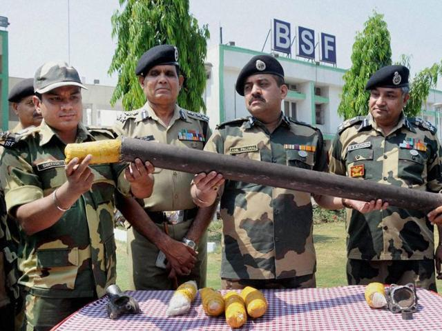 BSF officials display six packets of heroin, seized near the border outpost at Ghoga in Amritsar on Wednesday.