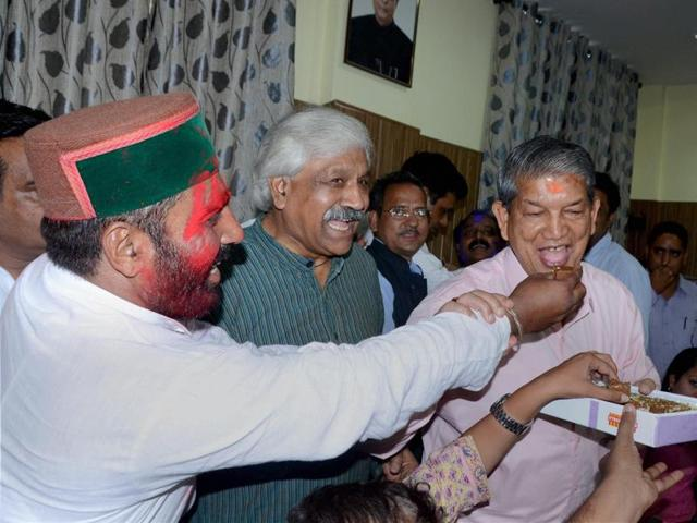 Congress leader Harish Rawat celebrates in Dehradun on Wednesday after the Supreme Court said that Rawat has won the trial of strength in the Uttarakhand assembly.