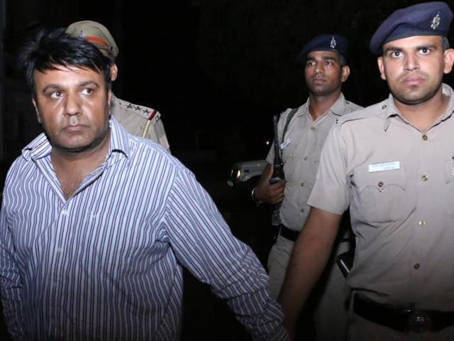 Vinod Verma in police custody.