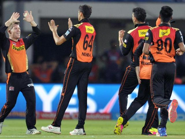 Sunrisers Hyderabad captain David Warner (L) celebrates with his teammates after winning the match against Rising Pune Supergiants.