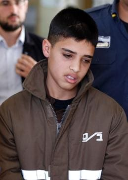 This file photo shows Ahmed Manasra, a Palestinian youth accused of taking part in the stabbing of two Israelis, being escorted by Israeli security during a hearing at a Jerusalem court.