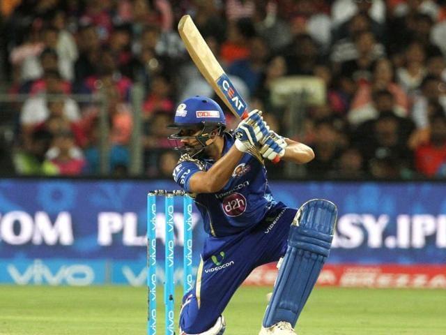 Mumbai Indians captain Rohit Sharma plays a shot during the IPL match against Rising Pune Supergiants at the Maharashtra Cricket Association's International Stadium in Pune on May 1, 2016.