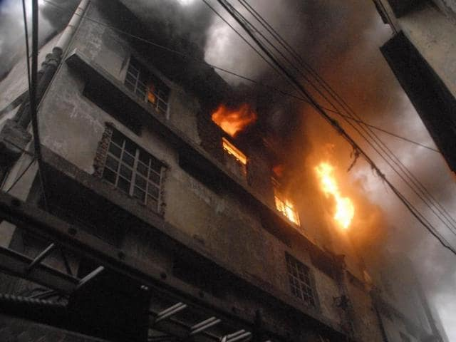 Flames blazing through the windows of the hosiery factory.