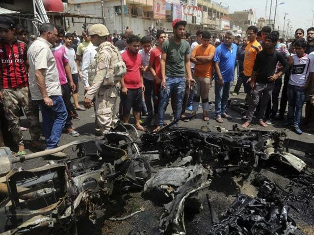 Three car bombs in Baghdad, including a huge blast at a market in a Shiite area, killed at least 94 people on Wednesday, the bloodiest day in the Iraqi capital this year.