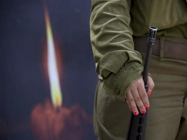 An Israeli soldier takes part in a rehearsal for a ceremony to mark Israel's Memorial Day for fallen soldiers.