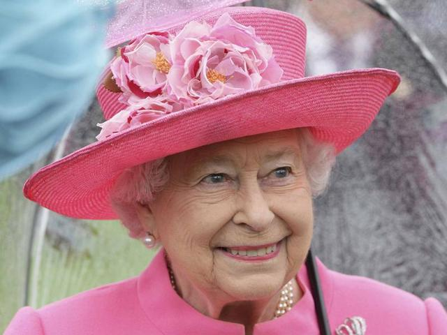Queen Elizabeth II in the garden of Buckingham Palace for the first royal garden party of the year, in London on Tuesday. The monarch had been overheard calling  Chinese officials 'very rude' at the event.