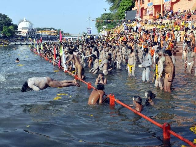 Pilgrimms take a holy dip at Ramghat Ghat in Kshipra river on Simhasth Kumbh in Ujjain. (Photo by Arun Mondhe/ Hindustan Times)