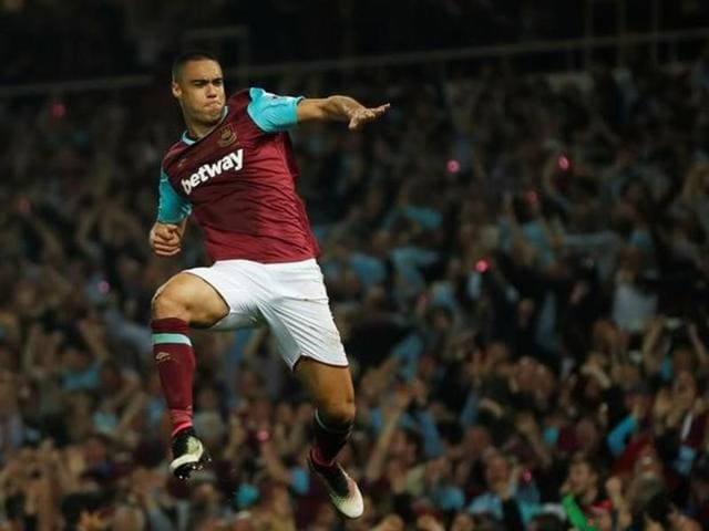 Winston Reid, right, celebrates scoring the winner for West Ham United.