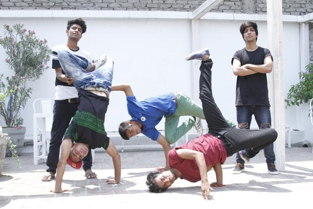 Slumgods show off some cool B-boying moves.