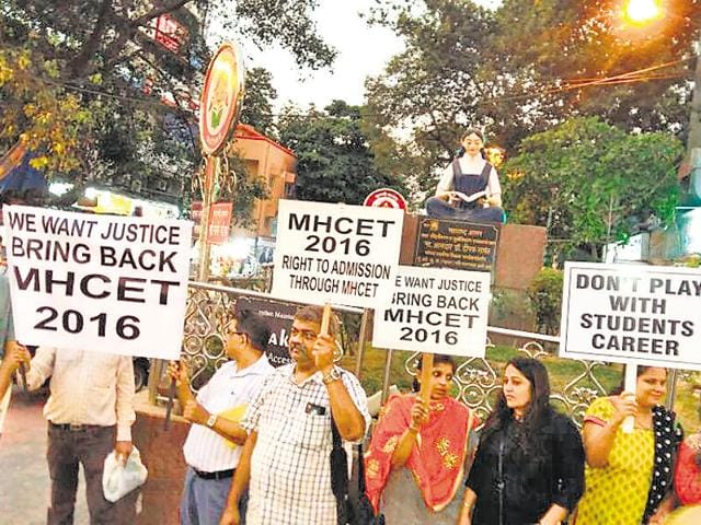 Parents of students who appeared for the recently conducted MH-CET protested outside Vile Parle railway station on Wednesday.