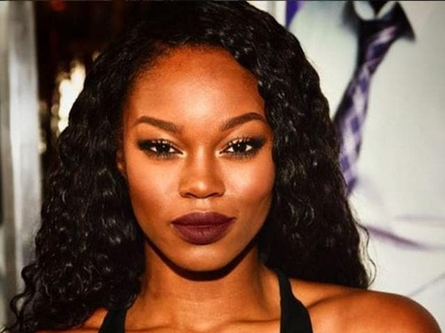 Eugena Washington, a model and actress from Palmdale, California, was unveiled at the opulent Playboy Mansion in Beverly Hills, posing for the world's media in front of her prize -- a Fiat 124 Spider sports car.