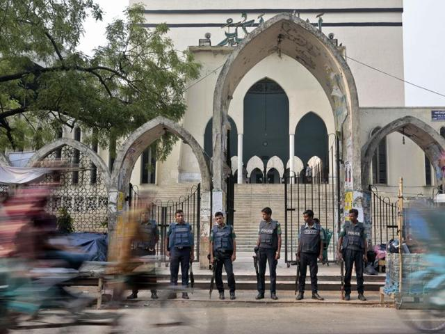 Bangladeshi policemen stand guard at the entrance to the National Mosque during a nationwide day-long strike called by Bangladesh's largest Islamist political party, Jamaat-e-Islami, in Dhaka, Bangladesh, on Thursday.