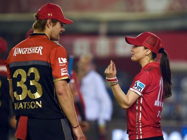 Co-owner of Kings XI Punjab Preity Zinta (R) talks to Royal Challengers Bangalore's Shane Watson after her team's one-run loss to RCBduring the IPL match in Mohali on May 9, 2016.