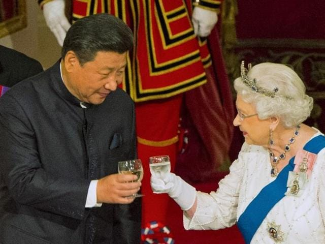 Chinese President Xi Jinping with Queen Elizabeth II at a state banquet at Buckingham Palace, London, during the first day of his state visit to Britain. Tuesday October 20, 2015.