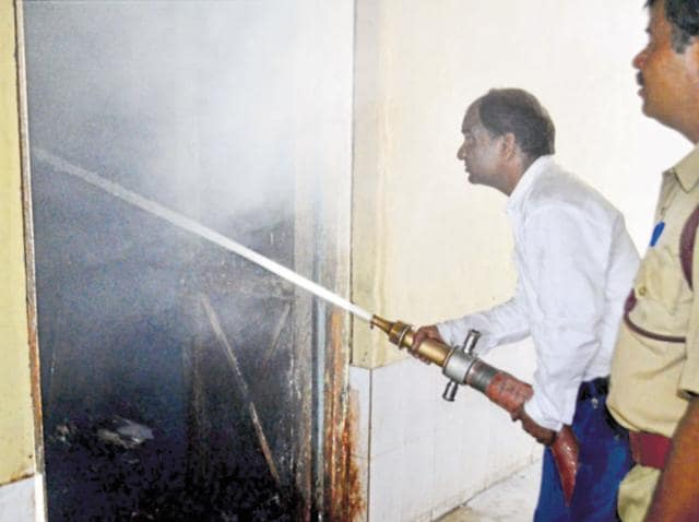 A fireman tries to douse the flame at the government hospital in Ajmer on Thursday.