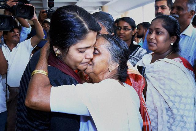 The first batch of 18 Keralites, evacuated from Libya, meet their families on their arrival at Kochi on Thursday. A war of words has broken out between CM Oommen Chandy and external affairs minister Sushma Swaraj for taking credit for the evacuation.