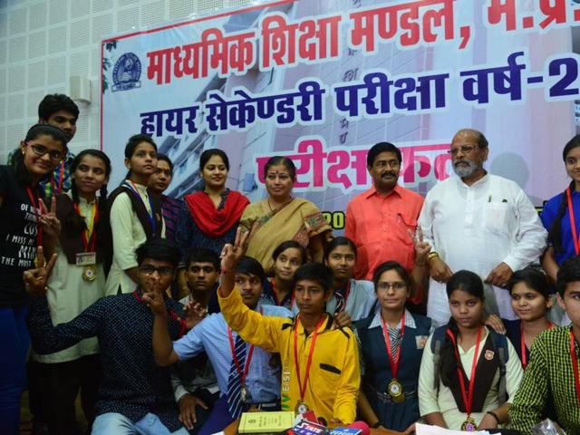 Meritorious students of MP board's higher secondary school examination with education ministers Paras Jain and Deepak Joshi, in Bhopal on Thursday.