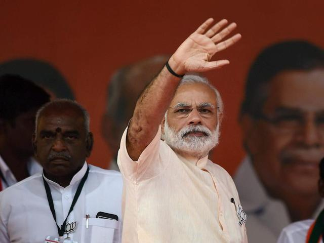Prime Minister Narendra Modi waves to a crowd at an election rally at Thethakudi in Nagappatinam district of Tamil Nadu.