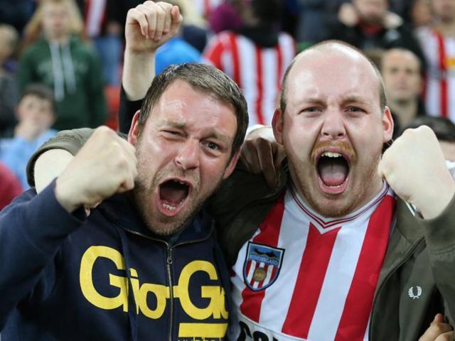 Sunderland's Fabio Borini (left) and Vito Mannone celebrate after the team's 3-0 win over Everton.