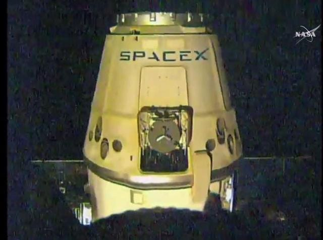 In this photo released by SpaceX, a SpaceX capsule containing science samples from NASA's one-year space station resident, approaches the Pacific Ocean, a few hundred miles off the Southern California coast, Wednesday.