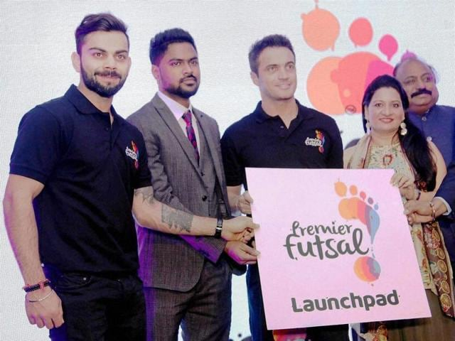 Virat Kohli with officials at the launch of the talent hunt to identify and pick players for the Premier Futsal League in Bengaluru.