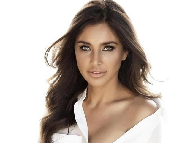 "Cancer survivor Lisa Ray talks about relapsing right after she got married in 2012; calls working with film-maker Ram Gopal Varma a ""fantastic experience"""
