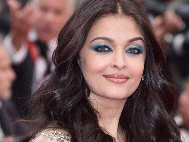 Aishwarya, 42, floated down the red carpet in a close-fitted Ali Younes beaded cape couture gown. She added a pop of colour with turquoise eye shadow, completing her look with middle-part waves.
