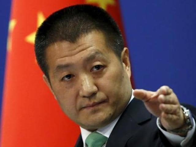 Chinese foreign ministry spokesperson Lu Kang points out a reporter to receive a question at a regular news conference in Beijing.