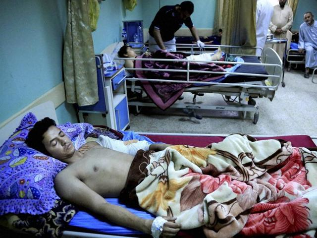 Victims of bombing attacks are treated at a hospital in Sadr City, Baghdad.