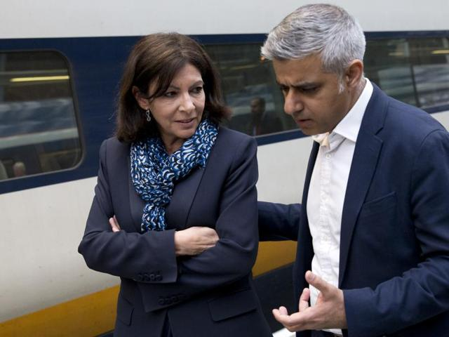 Mayor of London Sadiq Khan (R) speaks with Mayor of Paris Anne Hidalgo as they meet at St Pancras Station in London on May 10.