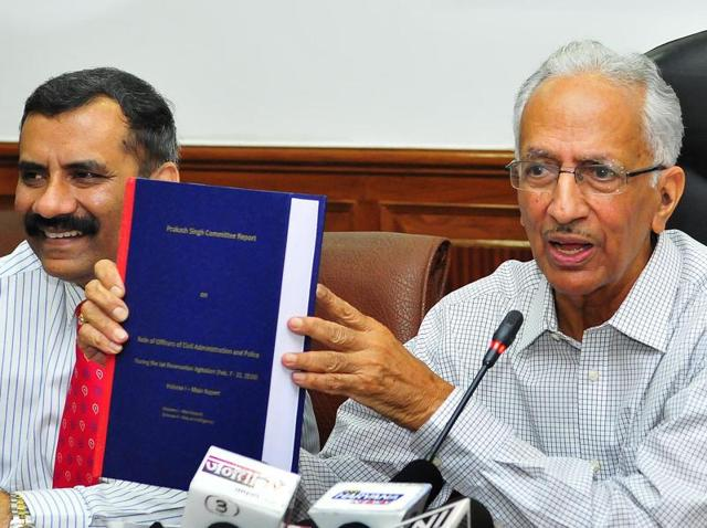 Prakash Singh (right), committee chairman, with his report. He submitted the report to Manohar Lal Khattar at the Haryana secretariat in Chandigarh on Friday.