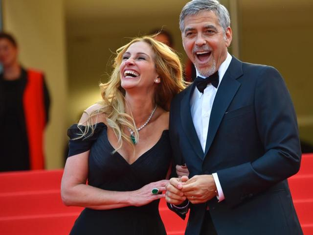 Julia Roberts with George Clooney as they arrive for the screening of the film Money Monster at the 69th Cannes Film Festival.