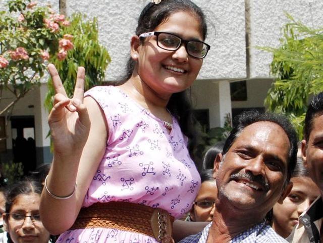 Mahima Nagpal with her father Sanjiv Nagpal in a jubilant mood in Ludhiana on Friday.