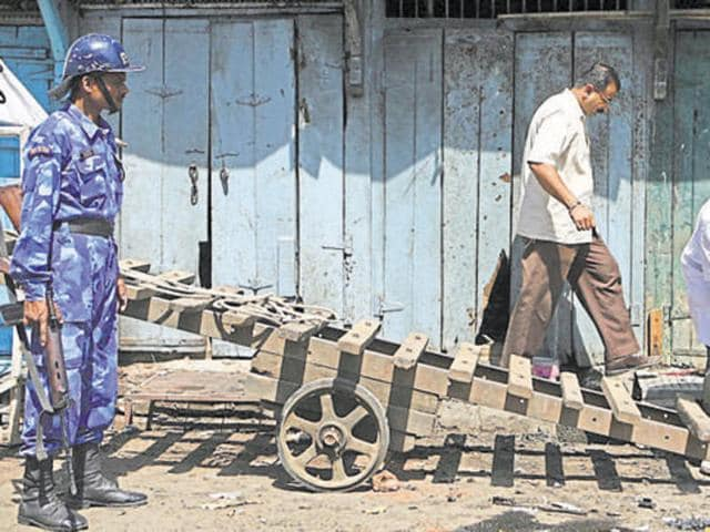 Investigators at the 2008 Malegaon blasts case look for clues.