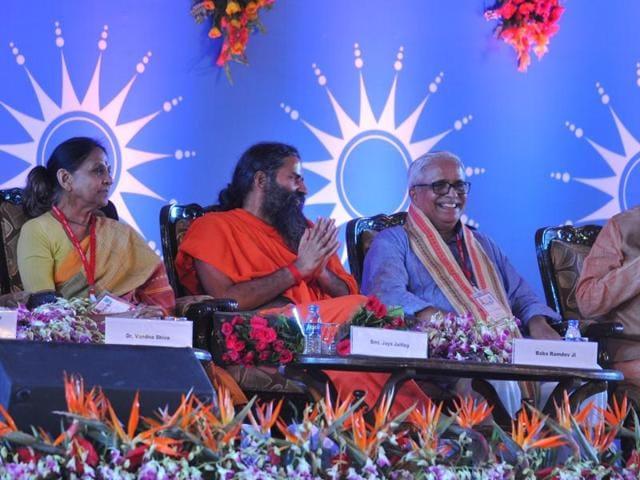 Yoga guru Baba Ramdev, chief minister Shivraj Singh Chouhan, RSS ideologue Suresh Bhaiyyaji Joshi and other dignitaries at international convention 'Living the Right Way' held in village Ninora near Ujjain on Friday.