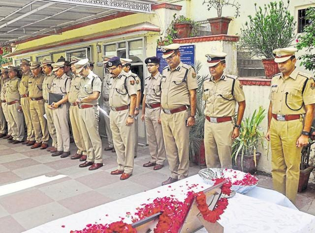 Police officers pay homage to victims of the Jaipur serial bomb blasts, on Friday.