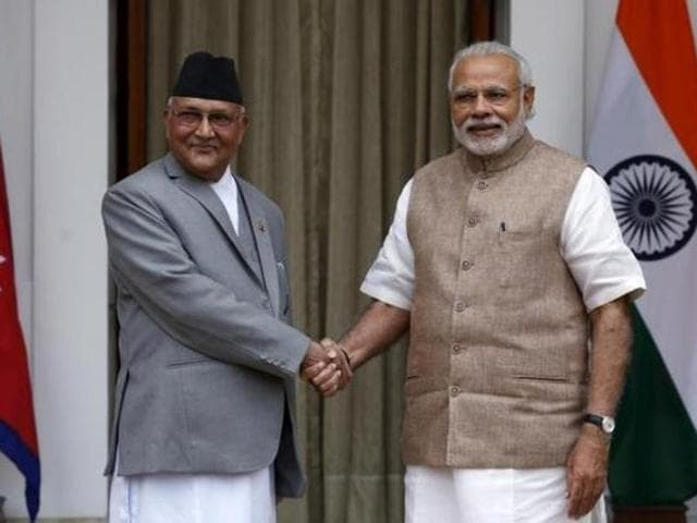 File photo of Nepal Prime Minister KP Sharma Oli (left) with his Indian counterpart Narendra Modi in New Delhi in February 2016.(Reuters)