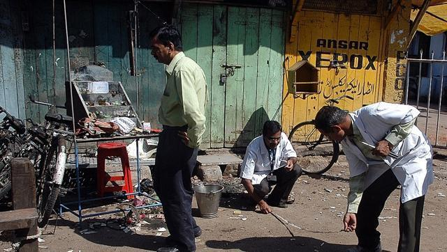 Forensic experts search for clues at the blast site in Malegaon.